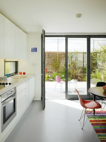 Modern kitchen leading into modern garden patio area