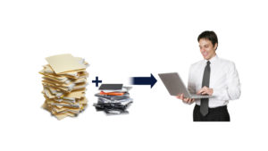 Man with pc reducing amount of paper used